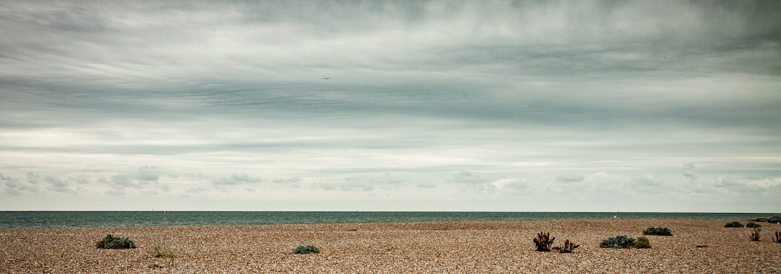 Image of the horizon stretching into the distance, beyond a shingle beach, you are only restricted by your imagination.